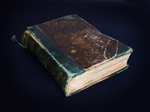 Vintage Broken Book against a black background