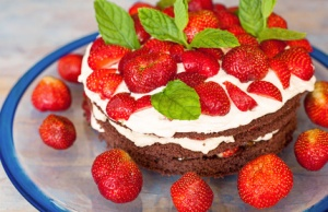 Traditionel midsummer cake in Sweden, strawberry and cream.
